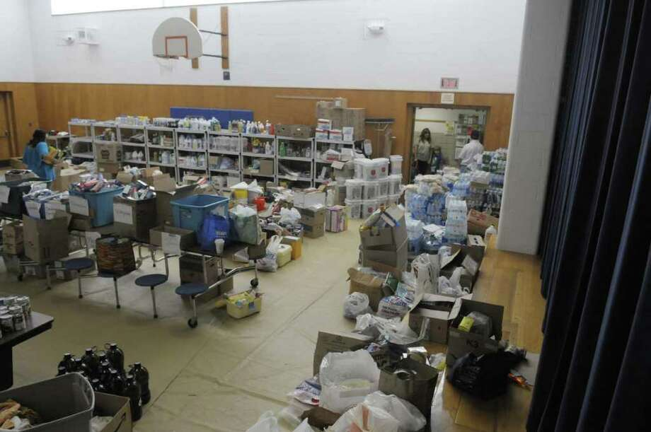 The gym in the elementary school is still being used to store cleanup supplies  and food for people who have been impacted by the flooding to come and get items they need.  Monday, Sept. 12, 2011 was the first day of school for students in the  Schoharie Central School district.  The school buildings were not damaged by flooding but the buildings were used to house and feed rescue and recovery workers in the area responding to the recent flooding and so the first day of school was delayed.   (Paul Buckowski / Times Union) Photo: Paul Buckowski  / 00014588A