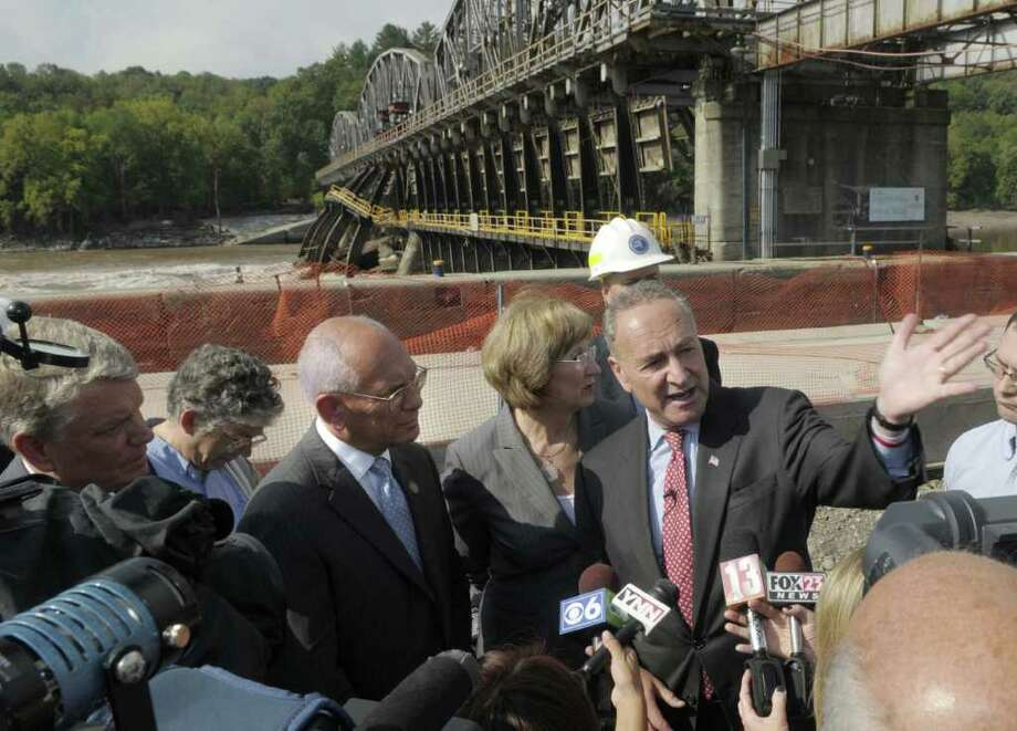 Senator Charles Schumer, right, talks with members of the media after touring the damage at Lock 11 on the Erie Canal in Amsterdam on Monday, Sept. 12, 2011.  Joining Senator Schumer on the tour was Brian Stratton, far left, director of the State's Canal Corporation, Congressman Paul Tonko, third from left, and Amsterdam Mayor Ann Thane. (Paul Buckowski / Times Union) Photo: Paul Buckowski  / 00014589A