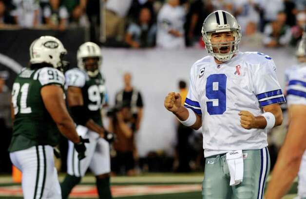 Cowboys quarterback Tony Romo had a costly fumble and interception in the fourth quarter. Photo: Henny Ray Abrams/Associated Press