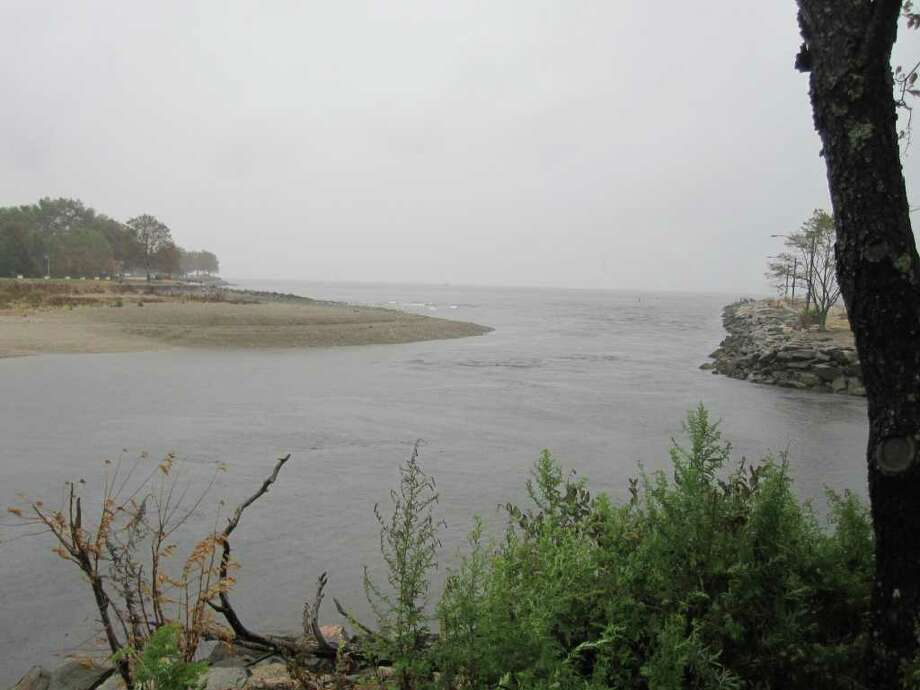 A rainy day view from the end of the Penfield Mills peninsula afford a close look at Ash Creek emptying into  Long Island Sound. On the right is the inlet to the South Benson Marina. Photo: Contributed Photo / Westport News