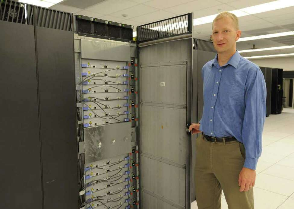 Jim Myers, CCNI director, stands in front of the existing Blue Gene supercomputer at Computational Center for Nanotechnology Innovations in North Greenbush, N.Y. Monday, Sept. 12, 2011. (Lori Van Buren / Times Union)