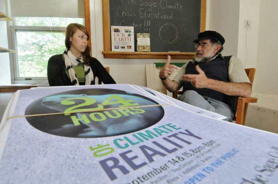 Russell Sage College Professor Steven Leibo, right, talks with graduate assistant Elizabeth Bennett, left, about the upcoming 24 Hours of Reality  global climate teach in with participants from around the world,  on Monday Sept. 12, 2011 in Albany, NY.  ( Philip Kamrass / Times Union) Photo: Philip Kamrass / 00014601A