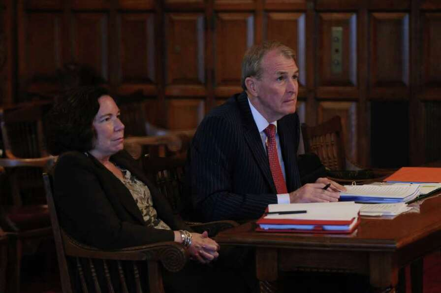 Attorneys Laurie Shanks, left, waits withTerence Kindlon before he makes his arguments to the State