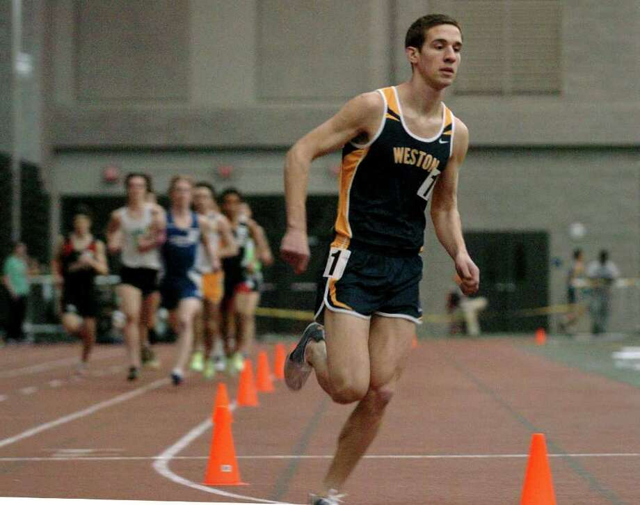Stephen Vento stays well ahead of the pack on his way to victory in the 3,200 meters at the Class S championships for Weston this past winter. Vento has taken his running talents to UConn, where he's a member of its cross country team and hopes to make its track team this winter. Photo: Christian Abraham / Staff Photographer