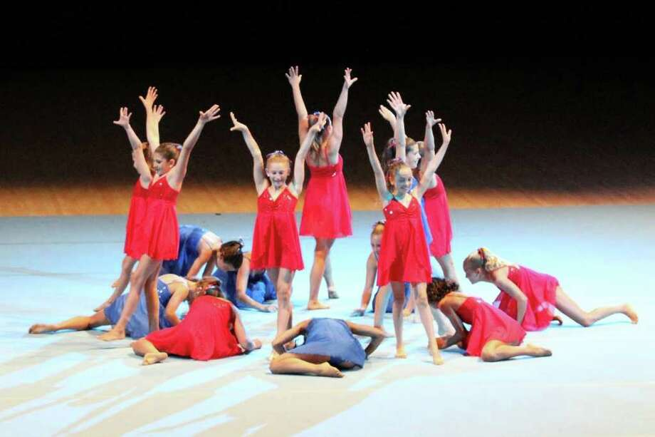 The Westport Family Y gymnasts display their grace in Switzerland this summer. Photo: Contributed Photo