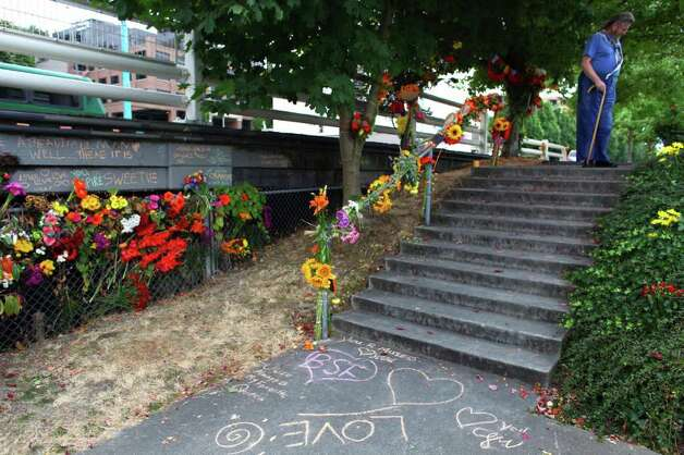 Flowers are shown at the site of an accident where bicycle commuter and local barista Brian Fairbrother crashed his bicycle in late August.  He recently died from the accident. Fairbrother died when his bike went down stairs on Fairview Avenue East. The stairs are difficult to see while traveling on the bike path. Photographed on Tuesday, September 13, 2011. Photo: JOSHUA TRUJILLO / SEATTLEPI.COM