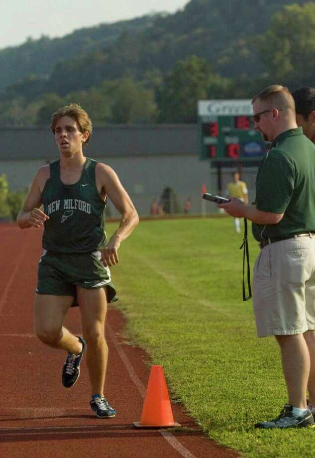 New Milford's Stephen Anderson crosses the finish line for first place during the boys cross country meet at New Milford High School on Tuesday, Sept. 13, 2011. Photo: Jason Rearick / The News-Times