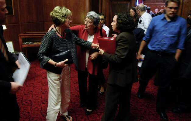 Joan Porco, left,  leaves the New York State Court of Appeals chamber after the appeal of her son Christopher Porco's murder and attempted murder conviction,  on Tuesday Sept. 13, 2011 in Albany, NY. Attorney Laurie Shanks is at right. ( Philip Kamrass / Times Union) Photo: Philip Kamrass / 00014607A