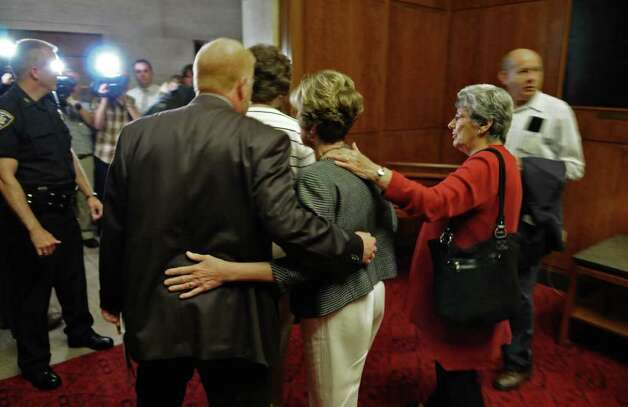 Joan Porco, center, is escorted out of the New York State Court of Appeals chamber after the appeal of her son Christopher Porco's murder and attempted murder conviction,  on Tuesday Sept. 13, 2011 in Albany, NY. Attorney Laurie Shanks is at right. ( Philip Kamrass / Times Union) Photo: Philip Kamrass / 00014607A