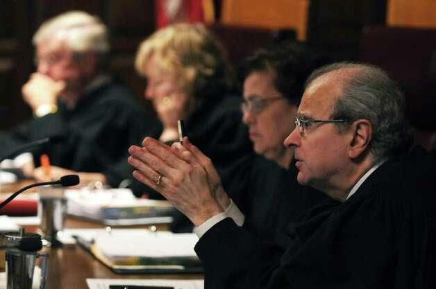 New York State Court of Appeals  Chief Judge Jonathan Lippman questions Christopher Horn, an attorney who handles appeals for the Albany County District Attorney's office, during oral arguments about Christopher Porco's murder and attempted murder conviction, on Tuesday Sept. 13, 2011 in Albany, NY.  ( Philip Kamrass / Times Union) Photo: Philip Kamrass / 00014607A