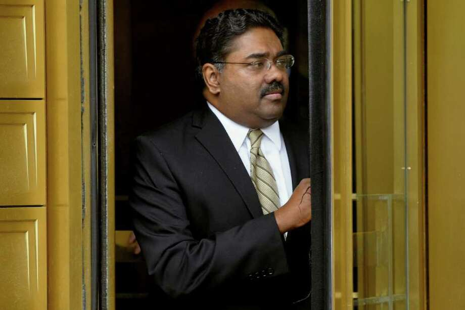 Raj Rajaratnam, co-founder of Galleon Group LLC, exits federal court in New York, U.S., on Wednesday, May 11, 2011. Photographer: Peter Foley/Bloomberg *** Local Caption *** Raj Rajaratnam Photo: Peter Foley, Bloomberg / © 2011 Bloomberg Finance LP