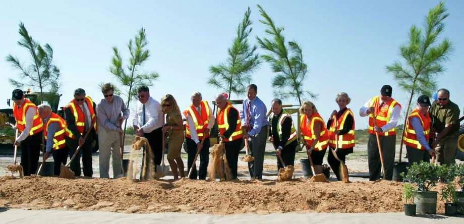 TxDot employees along with local and state officials shovel dirt during the Texas Department of Transportation's groundbreaking ceremony for SH 99 Grand Parkway Segment E Tuesday, Sept. 13, 2011, in Katy. Photo: James Nielsen, Chronicle / © 2011 Houston Chronicle