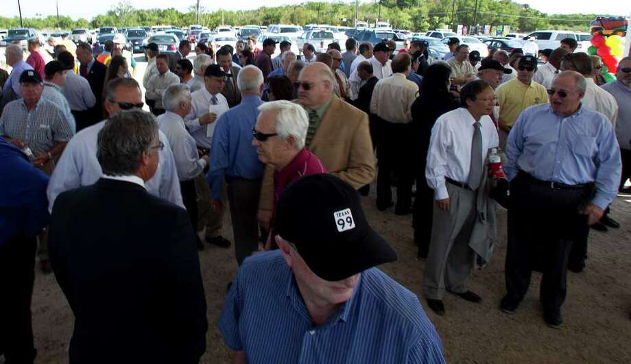 Pat Henry with TxDot wears a cap with Texas 99 during the Texas Department of Transportation's groundbreaking ceremony for SH 99 Grand Parkway Segment E Tuesday, Sept. 13, 2011, in Katy. Photo: James Nielsen, Chronicle / © 2011 Houston Chronicle