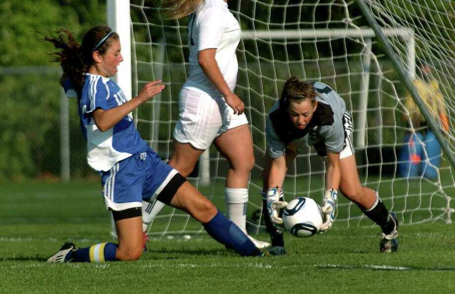 Highlights of girls soccer action between Staples and Fairfield Ludlowe in Westport, Conn. on Tuesday September 13, 2011. Staples' goalie Jessie Ambrose, right, stops the ball before Fairfield Ludlowe's #12 Gabrielle Rudolph can reach it. Photo: Christian Abraham / Connecticut Post