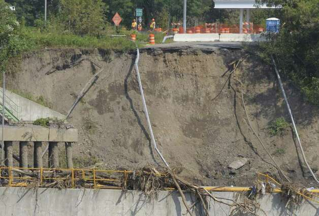 The damage can been seen of the washed away section of Route 103 that goes over the Mohawk River by Lock 9 on the Erie Canal on Tuesday, Sept. 13, 2011 from Rotterdam Junction.  (Paul Buckowski / Times Union) Photo: Paul Buckowski  / 00014614A
