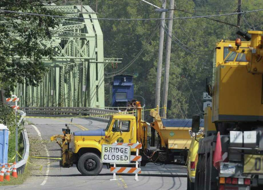 The Route 103 bridge that goes over the Mohawk River by Lock 9 on the Erie Canal is closed off on Tuesday, Sept. 13, 2011 as seen  from Rotterdam Junction.  A section of Route 103 on the other side of the bridge was washed away from recent flooding.  (Paul Buckowski / Times Union) Photo: Paul Buckowski  / 00014614A