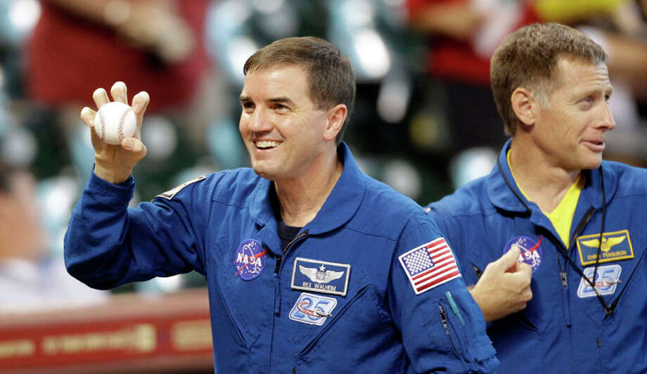 Space shuttle STS-135 mission specialist Rex Walheim, left, shows his knuckleball grip as he waits with commander Chris Ferguson, right, to throw out the first pitch before a baseball game between the Philadelphia Phillies and Houston Astros Tuesday, Sept. 13, 2011, in Houston. All four members of the of the last space shuttle mission crew threw out the first pitch. Photo: David J. Phillip, David J. Phillip/Associated Press / AP