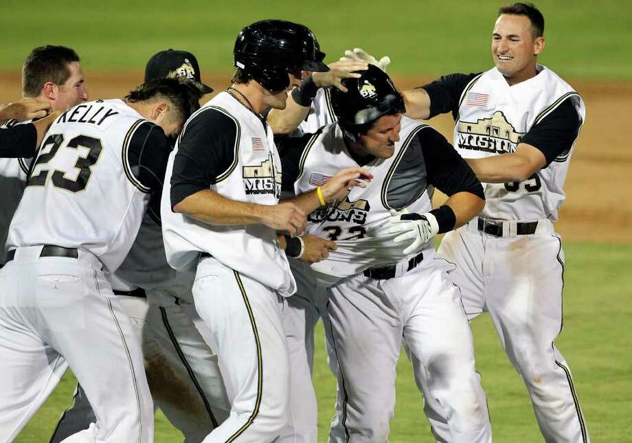 Missions players congratulate Jason Hagerty after he drew a game-winning, bases-loaded walk in the bottom of the ninth against the Arkansas Travelers in the opener of their Texas League championship series at Wolff Stadium on Tuesday, Sept. 13, 2011. Photo: Tom Reel/treel@express-news.net / © 2011 San Antonio Express-News