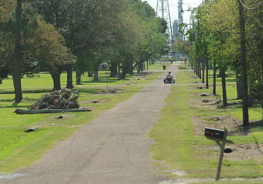 Rows of culverts are all that remain as evidence that more than 250 homes once filled the Fairlea addition next to the Total Port Arthur Refinery. In an effort to create a green zone, the facility has purchased and removed all but seven of the houses. Photo: Guiseppe Barranco