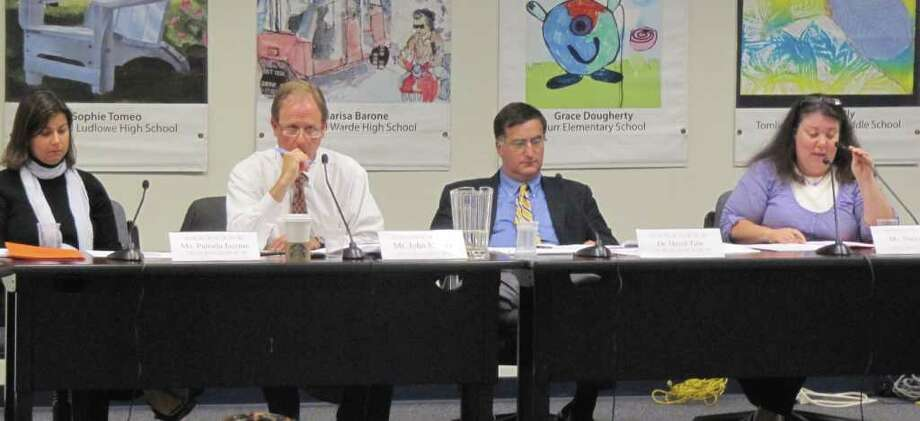 The Fairfield Board of Education reviewed a proposal for a comprehensive policy on bullying.Pictured, from left, are Board of Education Vice Chairwoman Pamela Iacono, Chairman John Mitola, Superintendent of Schools David Title and member Stacey Zahn. Photo: Kirk Lang / Fairfield Citizen