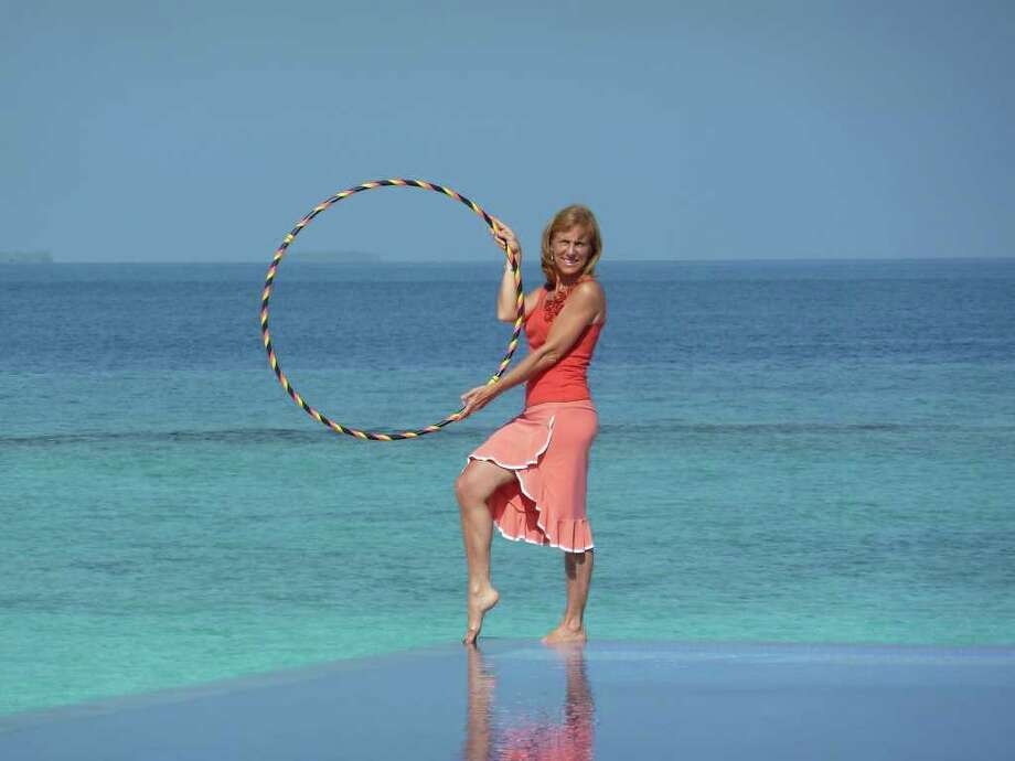 COURTESY PHOTOS BEAUTIFUL BACKDROP: Betty Lucas,  HoopChi instructor, filmed the tutorials for her HoopChi exercise class in the Maldives atolls in the Indian Ocean. Photo: Courtesy