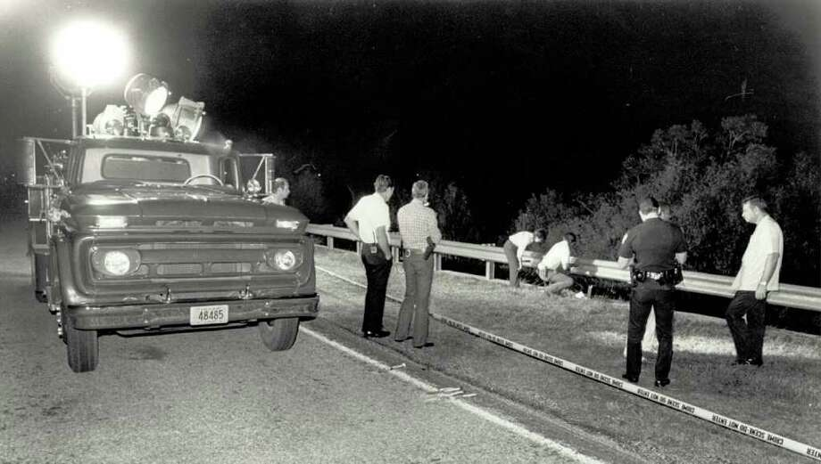Beaumont police search area near Major Drive where a body was found in October, 1985, using fire department light truck to aid their search. Enterprise file photo Photo: File