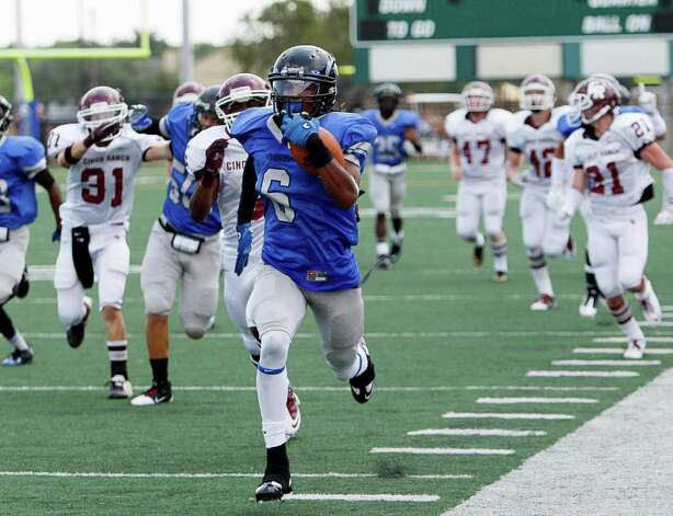 Clear Springs' Marcus Johnson #6 leaves the field behind him as he returns a kickoff 90 yards for a touchdown against Cinco Ranch during a high school football game Saturday, September 10, 2011 in League City, Texas, Photo: Bob Levey / ©2011 Bob Levey