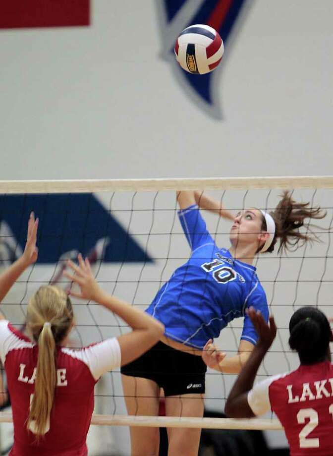 CODY DUTY: CHRONICLE SWING AWAY: Friendswood's Shannon Ellis, No. 10, gets ready to smash a shot during a recent match against Clear Lake. Photo: Cody Duty / © 2011 Houston Chronicle