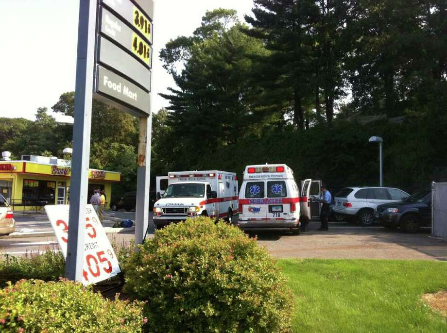 Fairfield firefighters and emergency medical technicians responded to an incident on Tuesday, September 14, 2011 at the Shell station on Black Rock Turnpike. The fire compression system went off, leaving cars covered in foam, but no one was injured. Photo: Tom Cleary
