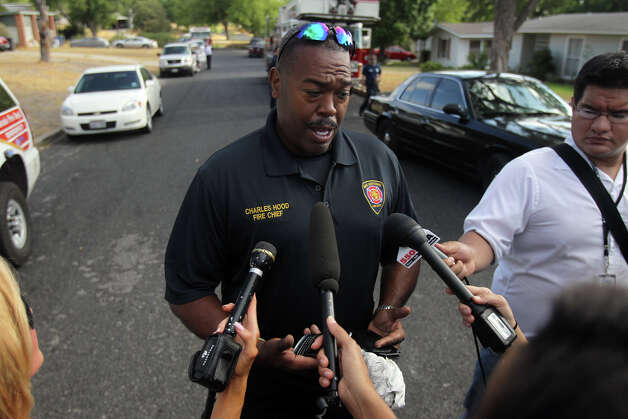 "SAFD Chief Charles Hood speaks with the media on Wednesday, Sept. 14, 2011 about a fatal fire at a home located in the 200 block of Karen Lane. ""It's obvious it's a crime scene,"" Hood said. Photo: John Davenport/jdavenport@express-news.net"