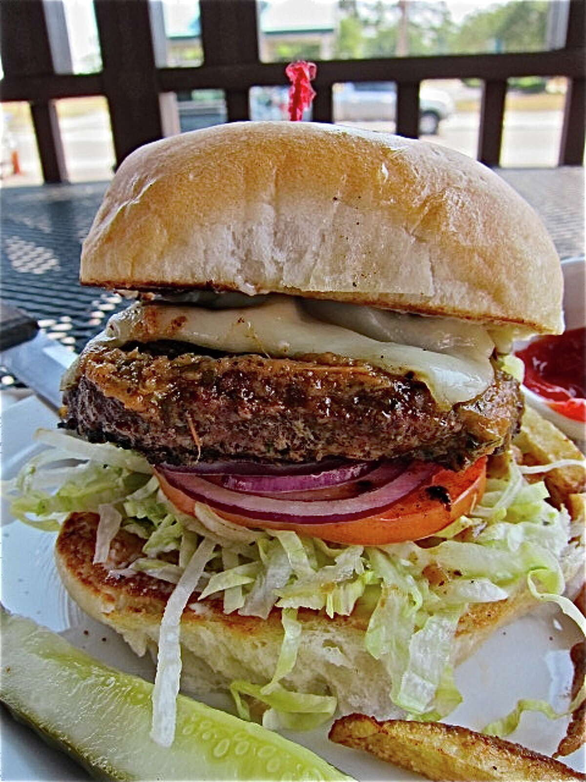 The half-pound Picante Burger at Facundo Cafe, in the Dr. Gleem Car Wash on Ella Blvd. Photo by Alison Cook
