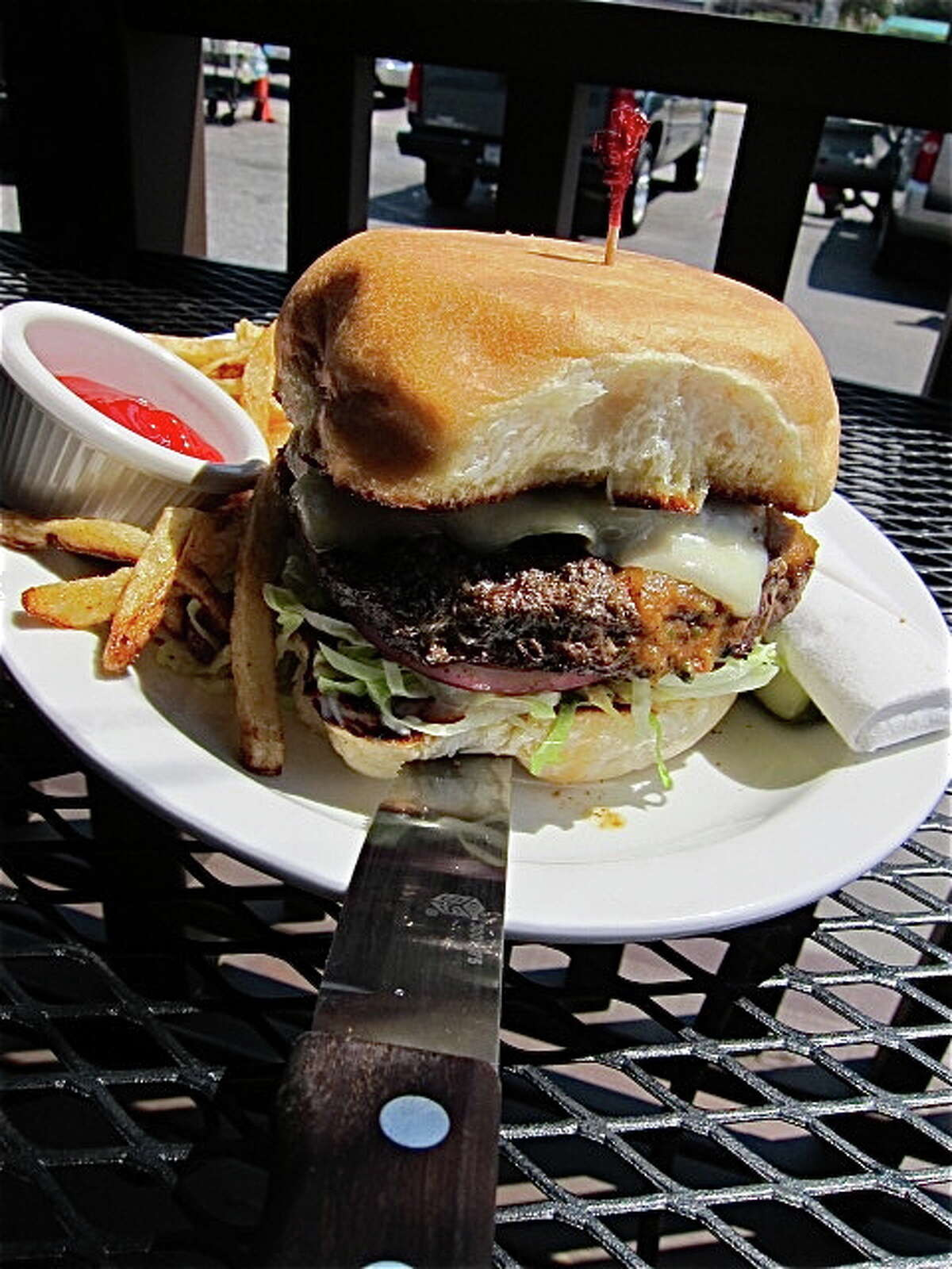 The half-pound Picante Burger with hand-cut fries at Facundo Cafe