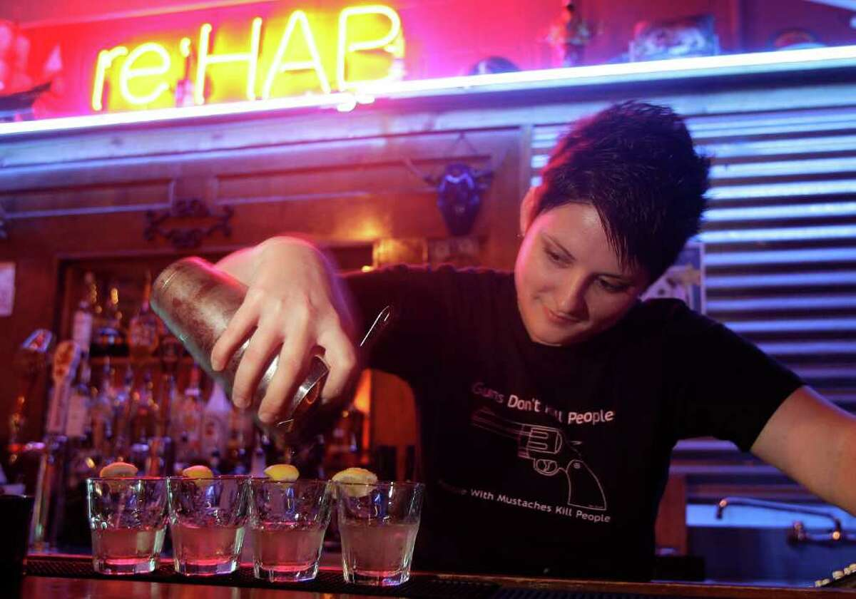 9/10/11 : Bartender Rachael Graves of the Houston Avenue Bar, makes chocolate cake shots. The shot consist of vodka, frengelico, and sugar lemon. The customer is supposed to shoot the shot then bight the lemon giving the taste of chocolate cake. The bar is located at 1920 Houston Avenue in Houston, Texas For the Chronicle: Thomas B. Shea