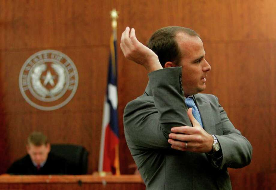 Prosecutor Nathan Hennigan explains to the jury how Michael Glyn Brown assaulted Rachel Brown in August of 2010. Photo: Mayra Beltran / © 2011 Houston Chronicle