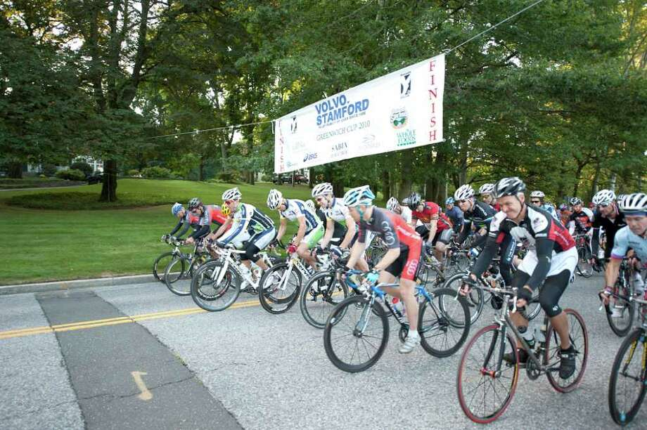 The Volvo of Stamford Tour de Greenwich XXVII, a 20-mile bicycle race, will begin at 7:30 a.m. this Sunday, Sept. 18, at Greenwich High School. Above, riders in the 2010 Tour de Greenwich take their marks at the starting line. Max Lippolis of Pound Ridge, N.Y., edged out Cos Cob resident Alex Weil in last year's race. Photo: Contributed Photo, ST / Greenwich Citizen