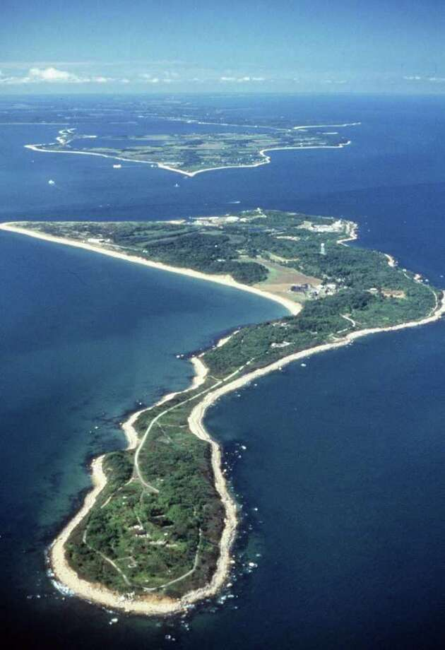 FILE - This undated file photo provided by the Agricultural Research Service of the U.S. Department of Agriculture shows Plum Island, a tiny island off the coast of New York's Long Island where the nation's primary animal disease laboratory is located. An Associated Press analysis of the country's food defense programs found that the U.S. government has spent at least $3.4 billion on food counter-terrorism in the last decade, but key programs have been bogged down in a huge, multi-headed bureaucracy. And with no single agency in charge, officials acknowledge it's impossible to measure whether orchards or feedlots are actually any safer. (AP Photo/USDA-ARS, File) Photo: Anonymous / AP2010