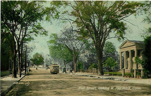An historic photo of Wall Street  looking west with the United Methodist Church in the distance. Photo: Courtesy Of The Norwalk Museum