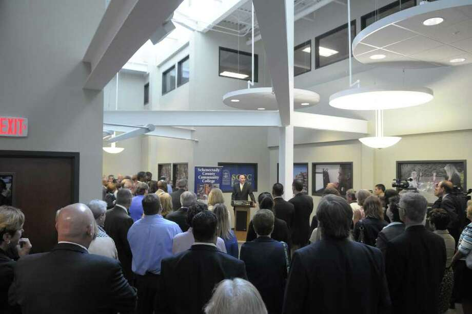 Matthew Grattan, executive director of Workforce Development at Schenectady County Community College, addresses those gathered at the grand opening event for the Schenectady County Community College classrooms at Center City on Wednesday, Sept. 14, 2011 in Schenectady.  Over 50 different classes will be held at the Center City location, serving more than 1,200 students this fall.  (Paul Buckowski / Times Union) Photo: Paul Buckowski / 00014581A