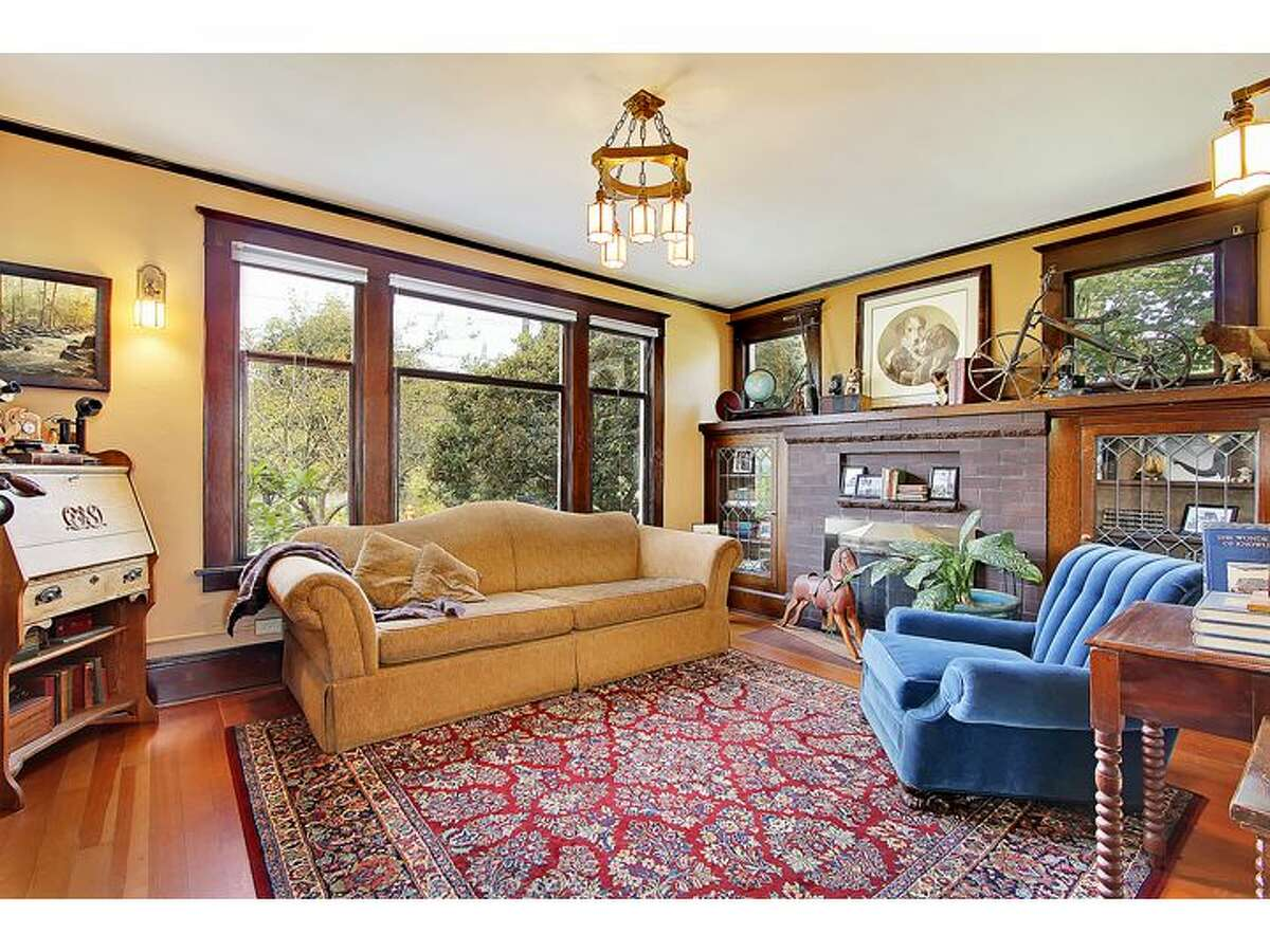 Living room of 1743 N.W. 61st St. The 2,840-square-foot home, built in 1903, has four bedrooms and 1.75 bathrooms, massive exposed-wood moldings and wainscoting, built-in cabinets with leaded glass, a landing that doubles as a family room, a claw-foot tub, an unfinished basement and a rear patio. It's listed for $589,000.