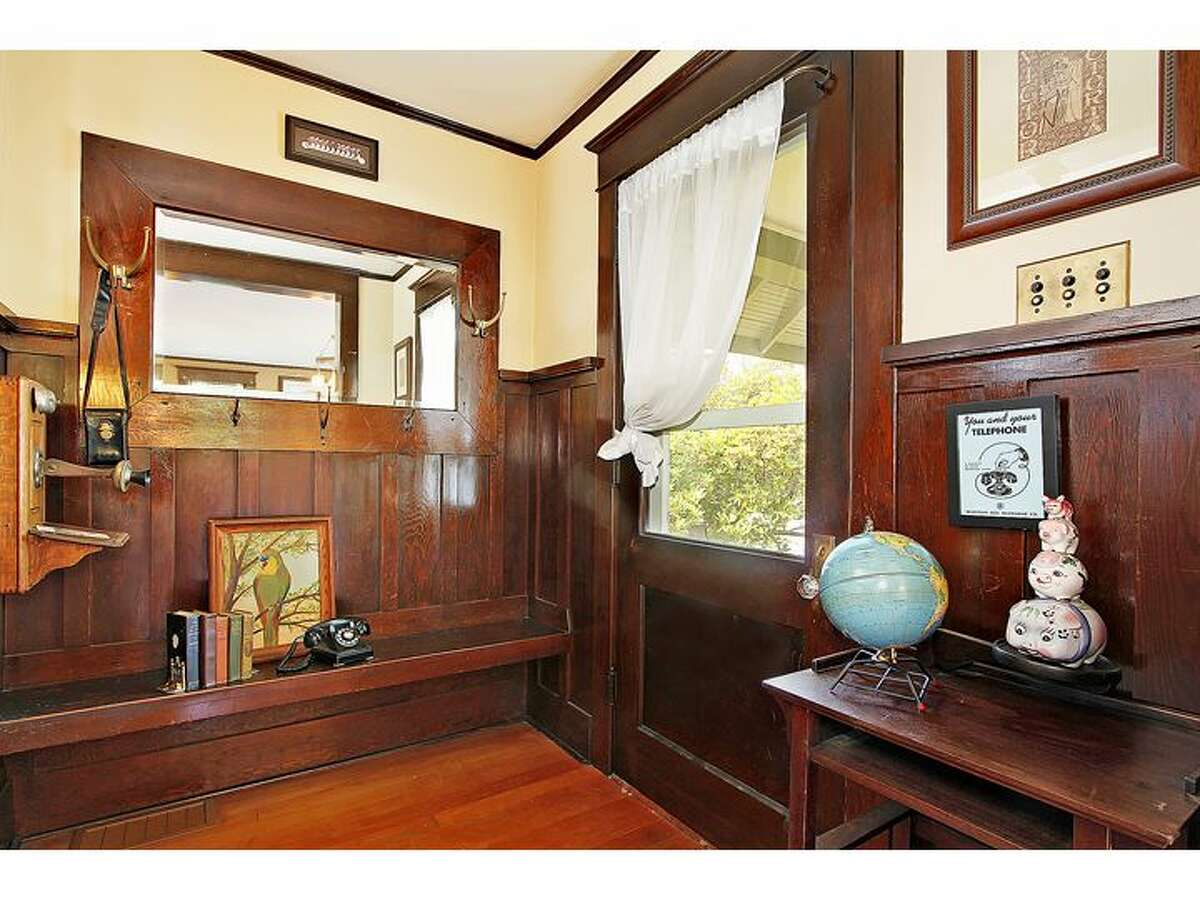 Entry of 1743 N.W. 61st St. The 2,840-square-foot home, built in 1903, has four bedrooms and 1.75 bathrooms, massive exposed-wood moldings and wainscoting, built-in cabinets with leaded glass, a landing that doubles as a family room, a claw-foot tub, an unfinished basement and a rear patio. It's listed for $589,000.