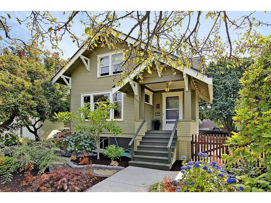 Most old Seattle houses have just two or three bedrooms. For those who need a little more space, here are a few homes in the greater Ballard area with at least four bedrooms and 1.75 bathrooms (one full, one with a shower) for less than $600,000, starting with this Craftsman at 1743 N.W. 61st St. The 2,840-square-foot home, built in 1903, has four bedrooms and 1.75 bathrooms, massive exposed-wood moldings and wainscoting, built-in cabinets with leaded glass, a landing that doubles as a family room, a claw-foot tub, an unfinished basement and a rear patio. It's listed for $589,000. Photo: Windermere Real Estate