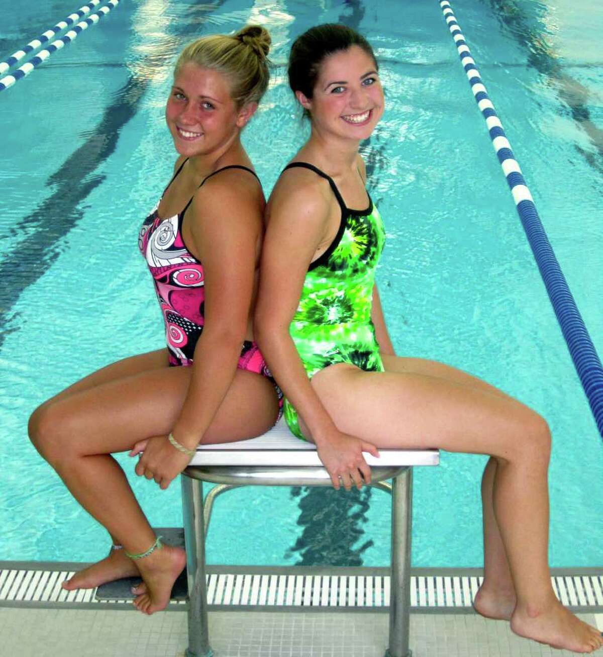 SPECTRUM/Maggie Heaton, left, and Toni Viola bring a wealth of swim team experience to their roles as captains for New Milford High School girls' swimming, September 2011