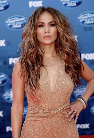 FILE - In this May 25, 2011 file photo, actress and singer Jennifer Lopez arrives at the American Idol Finale in Los Angeles. The Fox network has made Lopez's return official, along with her fellow judges, Aerosmith rocker Steven Tyler and record producer Randy Jackson. In addition, Fox said Wednesday that Ryan Seacrest will be back as host. (AP Photo/Matt Sayles, file) Photo: Matt Sayles, Associated Press / AP