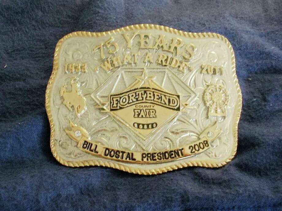 COURTESY PHOTO KEEPSAKE: The public can buy a belt buckle, such as the one above owned by Bill Dostal, to commemorate the Fort Bend County Fair's 75th anniversary.