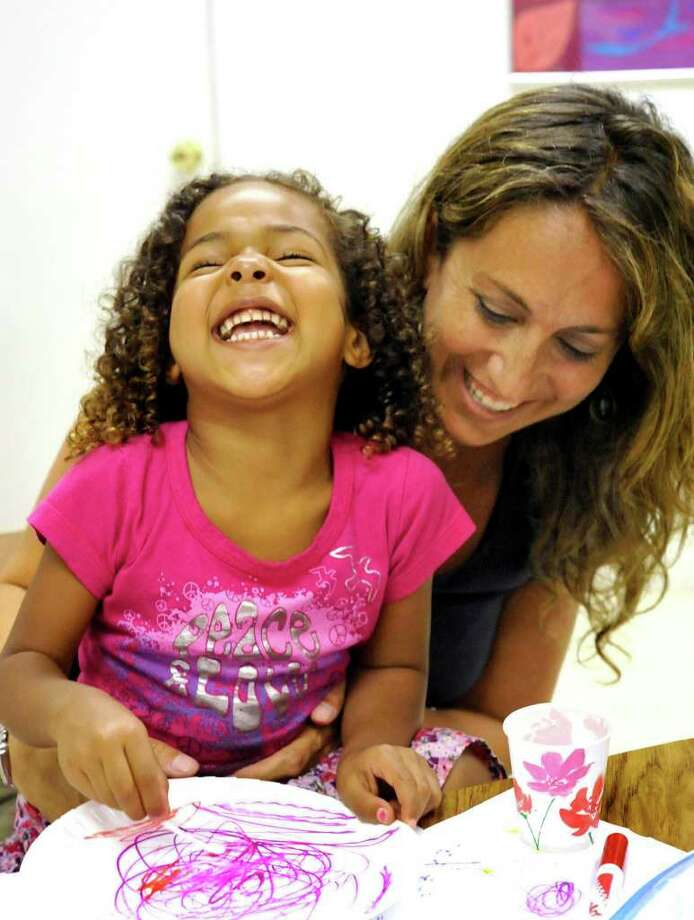 Leah Shaw, 3, has fun with her mom, Randie, during Summerfest 2011 at Congregation B'nai Israel in Danbury Sunday, Aug. 22, 2011. Photo: Michael Duffy / The News-Times