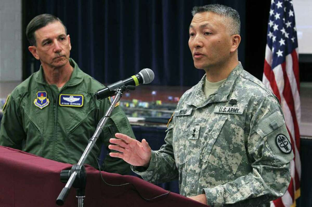 Army Maj. Gen. M. Ted Wong, commander of Brooke Army Medical Center and the Southern Regional Medical Command, along with Air Force Maj. Gen. Byron C. Hepburn, commander of the 59th Medical Wing, at a Defense Base Closure and Realignment Commission press conference at Fort Sam Houston.