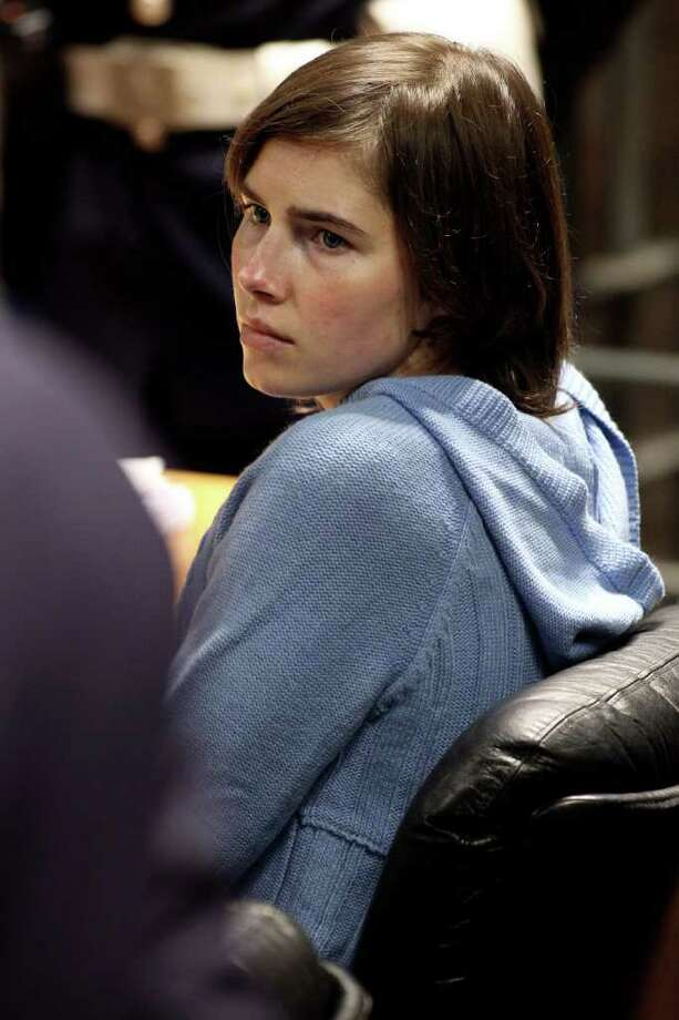 Knox and Sollecito both appealed the verdict. Here, Knox speaks to her legal team in Perugia's Court of Appeal during the first session of her appeal on Nov. 24, 2010. Photo: Oli Scarff, Getty Images / 2010 Getty Images