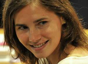 US Amanda Knox reacts in court before the start of a session of her appeal trial in Perugia's courthouse on July 25, 2011. Knox was sentenced in December 2009 to 26 years in prison for the 2007 killing of Leeds University student Meredith Kercher. AFP PHOTO / ALBERTO PIZZOLI