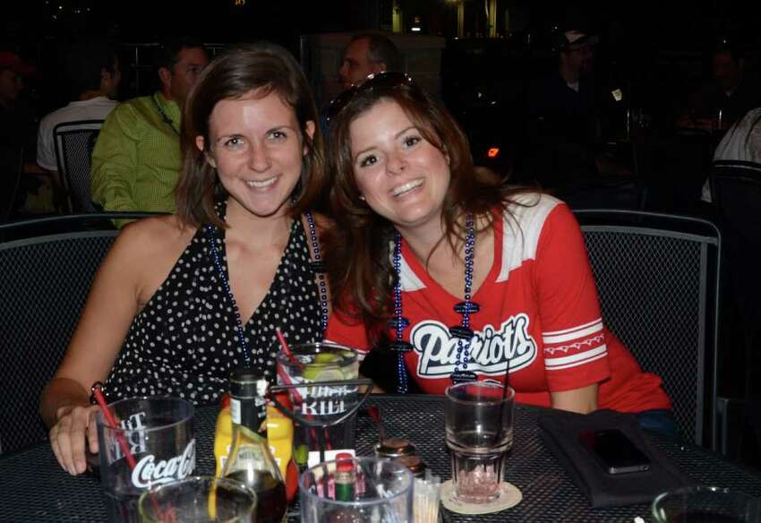 Emily Stone (left) and Kristen Starry drink with friends at Tilted Kilt. ROBIN JOHNSON / SPECIAL TO THE EXPRESS-NEWS