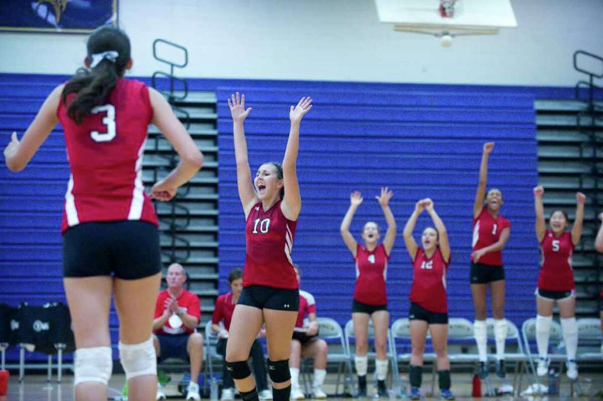 Greenwich girls react to their win as Westhill High School hosts Greenwich High in a girls volleyball match in Stamford, Conn., September 14, 2011. Greenwich won the match.